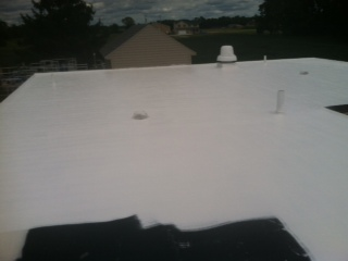 After Ohio Valley Roofing Systems Installed Waterproof Roof with Conklin Membrane Coating System in Xenia, OH