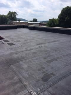Before of Bench Mark Coating a Commercial Roof at Elizabeth Chapel Church in Gallipolis, OH.